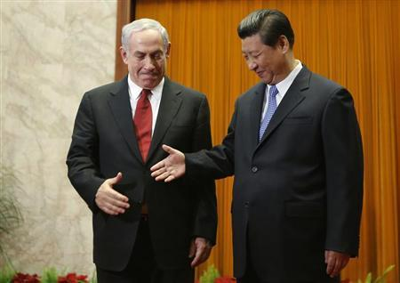 China's President Xi shakes hands with Israel's Prime Minister Netanyahu at the Great Hall of the People in Beijing