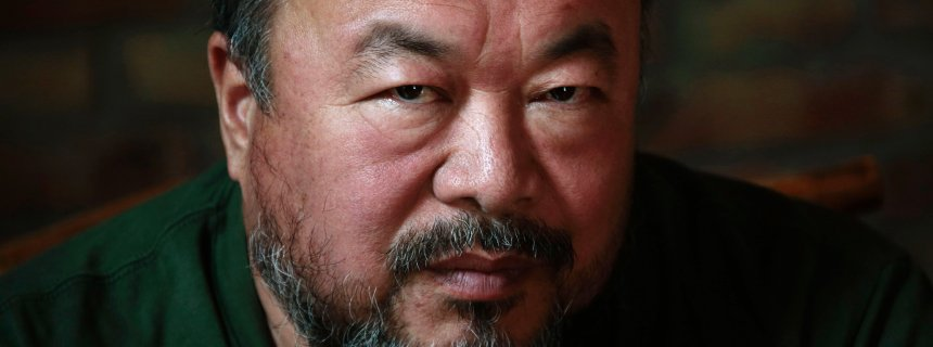 Dissedent Chinese artist Ai Weiwei reacts during a group interview at his studio in Beijing