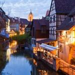 France, Alsace, Colmar, Krutenau, View of La Petite Venise quarters with restaurant near Lauch river and Caveau St. Pierre in background